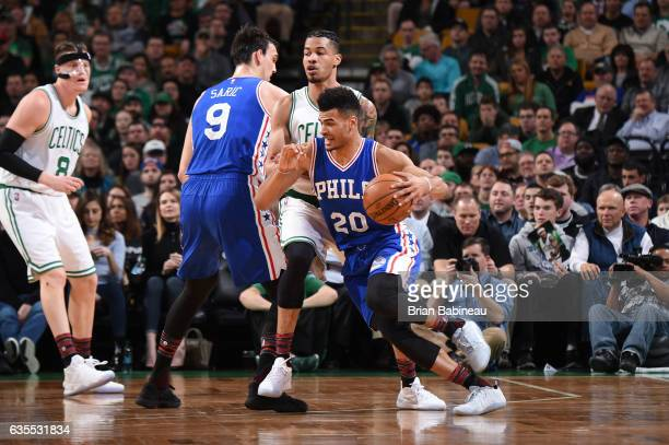 Timothe LuwawuCabarrot of the Philadelphia 76ers handles the ball during a game against the Boston Celtics on February 15 2017 at TD Garden in Boston...