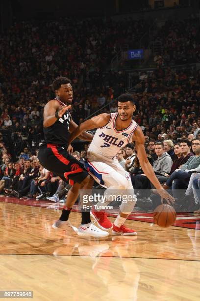 Timothe LuwawuCabarrot of the Philadelphia 76ers handles the ball against Kyle Lowry of the Toronto Raptors on December 23 2017 at the Air Canada...