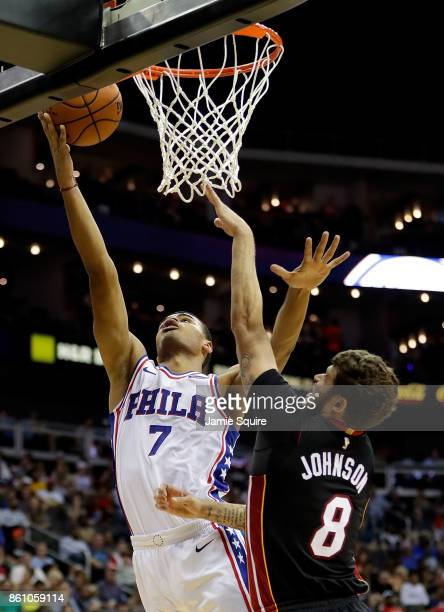 Timothe LuwawuCabarrot of the Philadelphia 76ers shoots as Tyler Johnson of the Miami Heat defends during the 2nd quarter of the game at Sprint...
