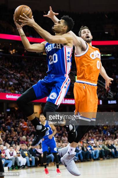 Timothe LuwawuCabarrot of the Philadelphia 76ers shoots over Kevin Love of the Cleveland Cavaliers during the first quarter at Quicken Loans Arena on...