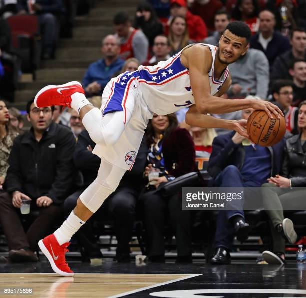 Timothe LuwawuCabarrot of the Philadelphia 76ers tries to keep the ball from going out of bounds against the Chicago Bulls at the United Center on...
