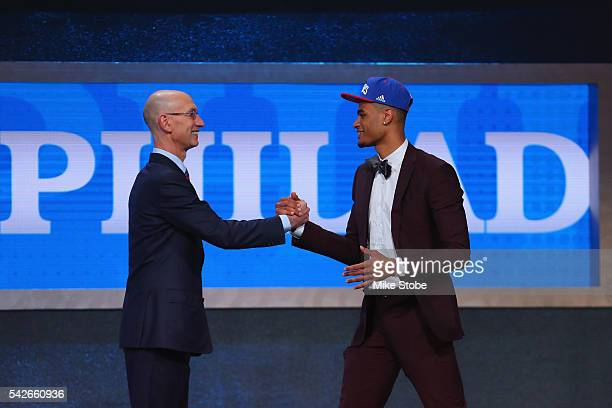 Timothe LuwawuCabarrot shakes hands with Commissioner Adam Silver after being drafted 24th overall by the Philadelphia 76ers in the first round of...