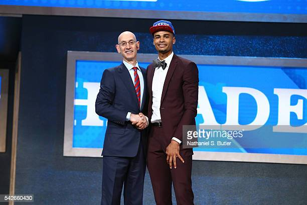 Timothe LuwawuCabarrot shakes hands with NBA Commissioner Adam Silver after being selected number twenty four overall by the Philadelphia 76ers...
