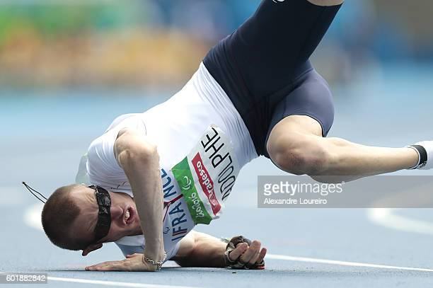 Timothee Adolphe of France falls after he crosses the finish line in the men's 100 meter T11 round 1 on day 3 of the Rio 2016 Paralympic Games at on...