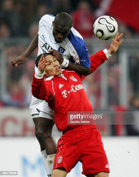 Timothee Atouba of Hamburger SV challenges Paolo Guerrero of Bayern Munich during the last sixteen match of the DFB German Cup between FC Bayern...