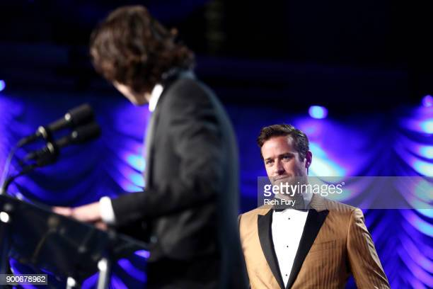 Timothee Chalamet and Arnie Hammer onstage at the 29th Annual Palm Springs International Film Festival Awards Gala at Palm Springs Convention Center...