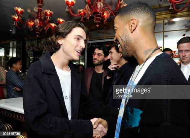 Timothee Chalamet and Kid Cudi attend GQ and Oliver Peoples Celebrate Timothee Chalamet March Cover Dinner at Nomad Los Angeles on February 20 2018...