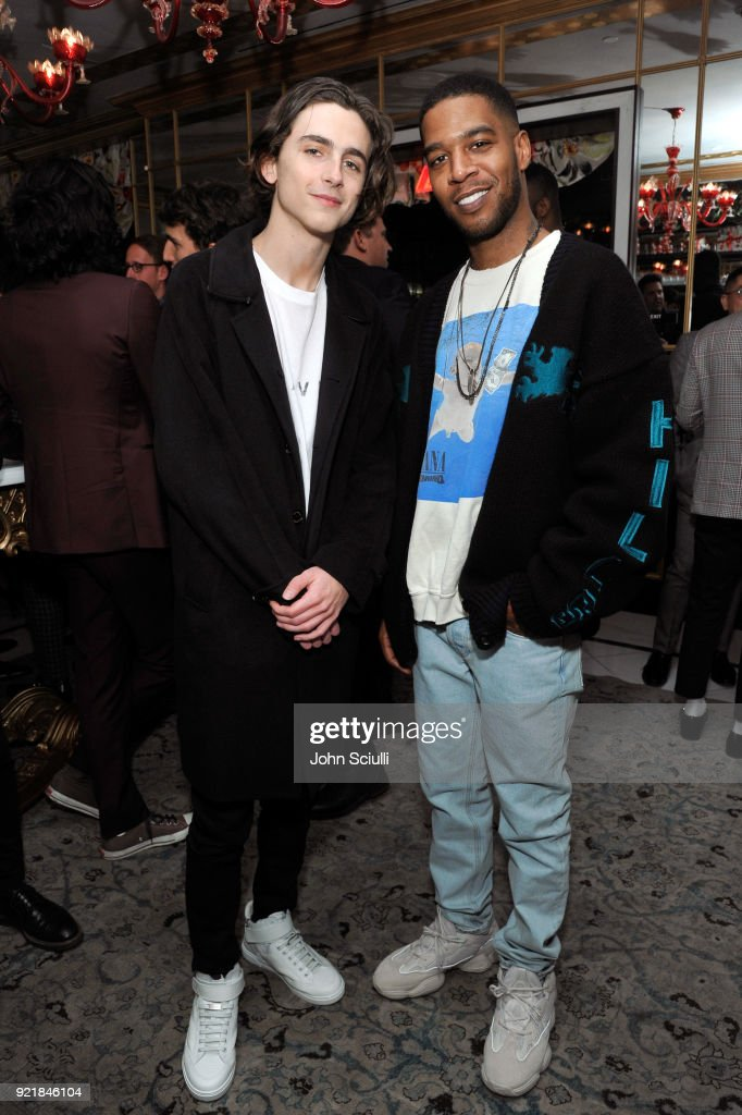 Timothee Chalamet (L) and Kid Cudi attend GQ and Oliver Peoples Celebrate Timothee Chalamet March Cover Dinner at Nomad Los Angeles on February 20, 2018 in Los Angeles, California.