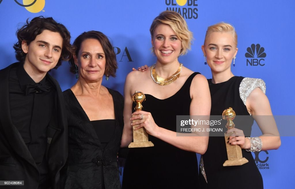 TOPSHOT - Timothee Chalamet, Laurie Metcalf, Greta Gerwig and Saoirse Ronan poses with the award for Best Motion Picture Musical or Comedy in 'Lady Bird' during the 75th Golden Globe Awards on January 7, 2018, in Beverly Hills, California. / AFP PHOTO / Frederic J. BROWN