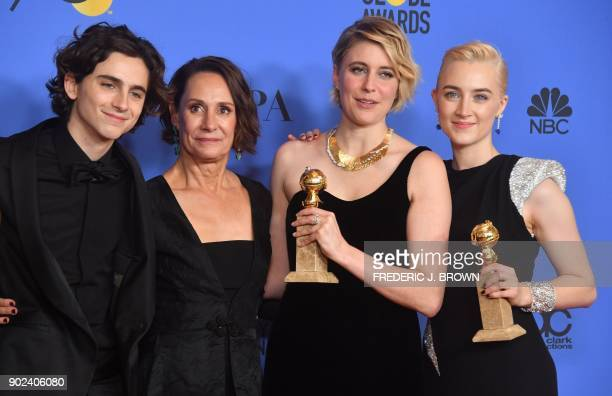 Timothee Chalamet Laurie Metcalf Greta Gerwig and Saoirse Ronan poses with the award for Best Motion Picture Musical or Comedy in 'Lady Bird' during...