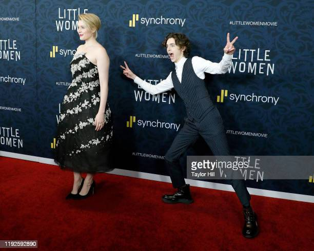 """Timothee Chalamet photobombs Greta Gerwig at the world premiere of """"Little Women"""" at Museum of Modern Art on December 07, 2019 in New York City."""