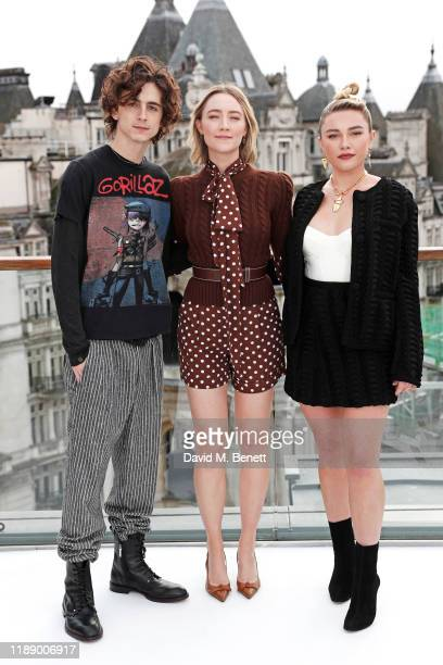 """Timothee Chalamet, Saoirse Ronan and Florence Pugh pose at a morning photocall for """"Little Women"""" at the Corinthia Hotel London on December 16, 2019..."""