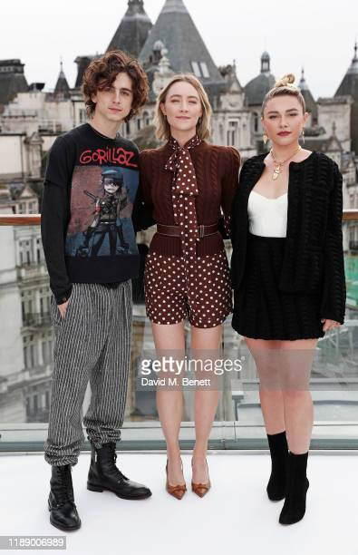 Timothee Chalamet Saoirse Ronan and Florence Pugh pose at a morning photocall for Little Women at the Corinthia Hotel London on December 16 2019 in...