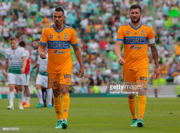 Timothee Kolodziedjczak and Andrepierre Gignac of Tigres leave the field after the quarter finals second leg match between Santos Laguna and Tigres...