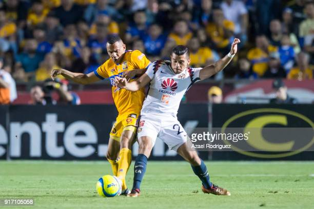 Timothee Kolodziejczak of Tigres fights for the ball with Henry Martin of America during the 6th round match between Tigres UANL and America as part...
