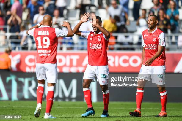 Timothee NKada of Reims, Alaixys Romao of Reims and Yunis Abdelhamid of Reims celebrate their victory after the French Ligue 1 football match between...