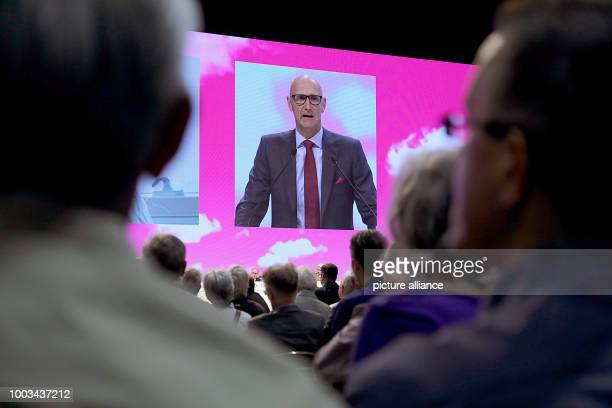 Timotheus Hoettges chairman of Deutsche Telekom speaks to the shareholders at the general assembly in Cologne Germany 31 May 2017 Photo Oliver...