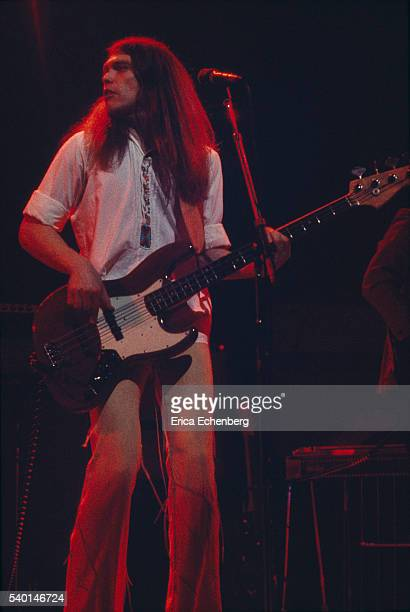 Timothy B. Schmit of American country rock band Poco performs on stage, London, 1976.
