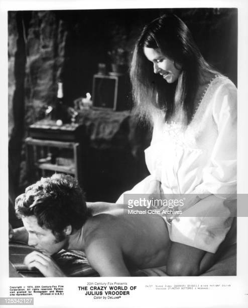 Timothy Bottoms gets massage from Barbara Seagull in a scene from the film 'The Crazy World Of Julius Vrooder' 1974