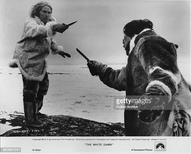 Timothy Bottoms is confronted by Joanasie Salamonie in a scene from the Paramount Pictures movie The White Dawn circa 1974