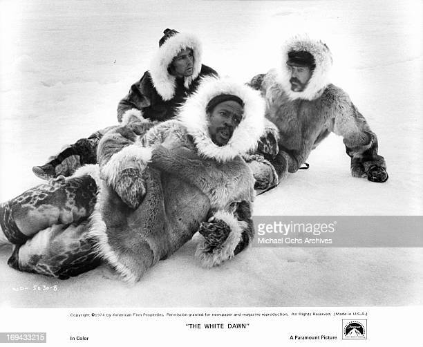 Timothy Bottoms Louis Gossett Jr and Warren Oates are three whalers marooned in the Canadian arctic in a scene from the film 'The White Dawn' 1974