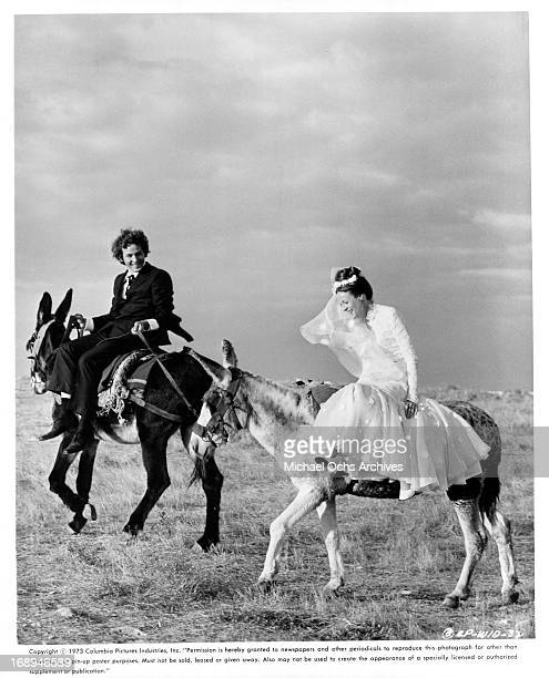 Timothy Bottoms rides with Maggie Smith in a scene from the film 'Love And Pain And The Whole Damn Thing' 1973