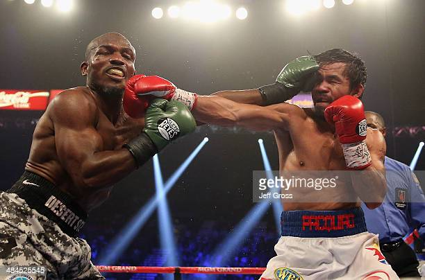 Timothy Bradley and Manny Pacquiao trade punches at the MGM Grand Garden Arena on April 12 2014 in Las Vegas Nevada