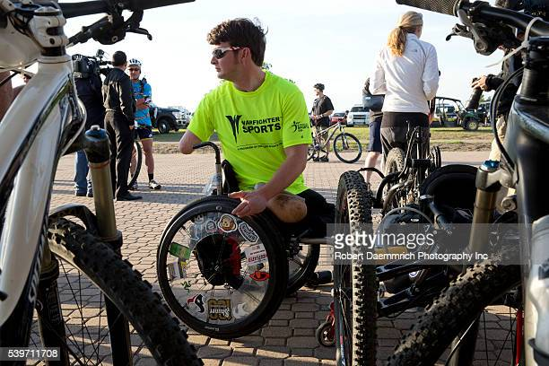 Timothy Brown prepares his bike as Former President George W Bush hosts bicycle riders through his Prairie Chapel Ranch outside Crawford Texas in the...