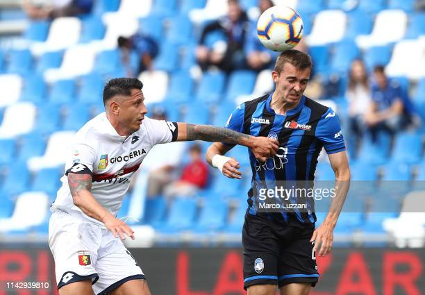 Timothy Castagne of Atalanta BC competes for the ball with Gianluca Lapadula of Genoa CFC during the Serie A match between Atalanta BC and Genoa CFC...