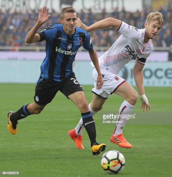 Timothy Castagne of Atalanta BC is challenged by Filip Helander of Bologna FC during the Serie A match between Atalanta BC and Bologna FC at Stadio...