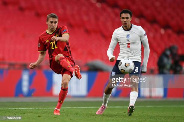 Timothy Castagne of Belgium shoots past Trent Alexander-Arnold of England during the UEFA Nations League group stage match between England and...