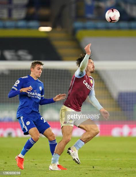 Timothy Castagne of Leicester City and Jack Grealish of Aston Villa battle for the ball during the Premier League match between Leicester City and...