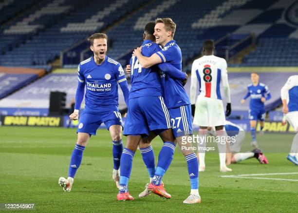 Timothy Castagne of Leicester City celebrates with Kelechi Iheanacho of Leicester City after scoring to make it 1-1 during the Premier League match...