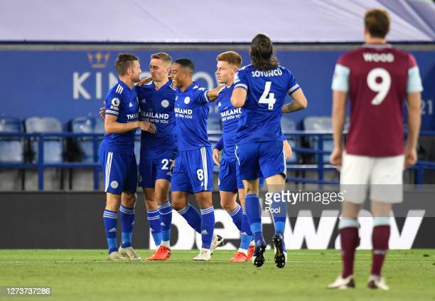 Timothy Castagne of Leicester City celebrates with teammates after scoring his team's second goal during the Premier League match between Leicester...