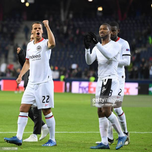 Timothy Chandler and Almamy Toure of Frankfurt celebrate after the UEFA Europa League round of 16 second leg match between RB Salzburg and Eintracht...
