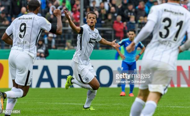 Timothy Chandler of Eintracht Frankfurt celebrates the first goal for his team with his teammates during the DFB Cup match between TuS Erndtebrueck...