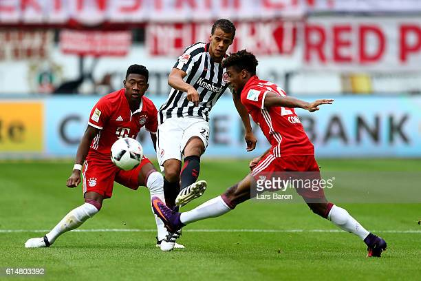 Timothy Chandler of Frankfurt and David Alaba and Kingsley Coman of Bayern Muenchen battle for the ball during the Bundesliga match between Eintracht...