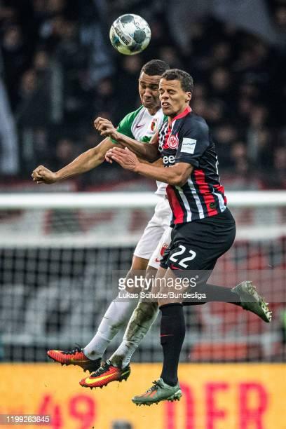Timothy Chandler of Frankfurt and Felix Uduokhai of Augsburg in action during the Bundesliga match between Eintracht Frankfurt and FC Augsburg at...