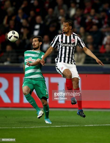 Timothy Chandler of Frankfurt and Garcia Santiago of Bremen battle for the ball during the Bundesliga match between Eintracht Frankfurt and Werder...