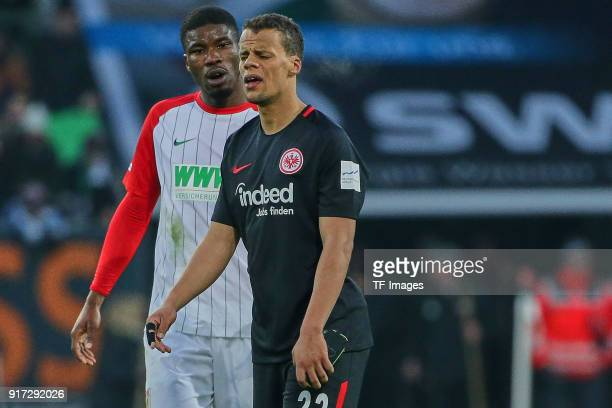 Timothy Chandler of Frankfurt and Kevin Danso of Augsburg look on after the Bundesliga match between FC Augsburg and Eintracht Frankfurt at WWKArena...