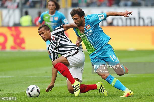 Timothy Chandler of Frankfurt is challenged by Admir Mehmedi of Leverkusen during the Bundesliga match between Eintracht Frankfurt and Bayer 04...