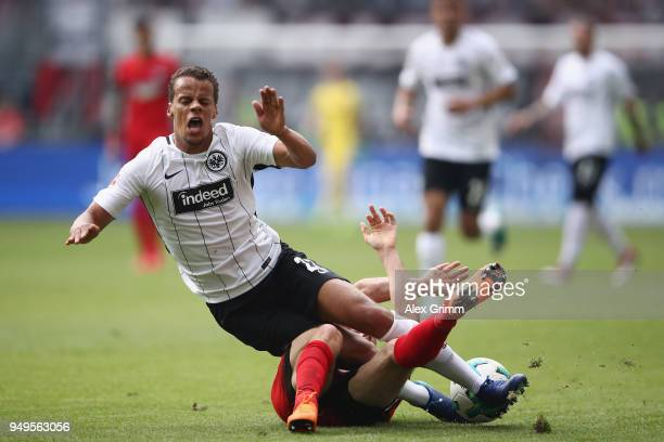 Timothy Chandler of Frankfurt is challenged by Matthew Leckie of Berlin during the Bundesliga match between Eintracht Frankfurt and Hertha BSC at...