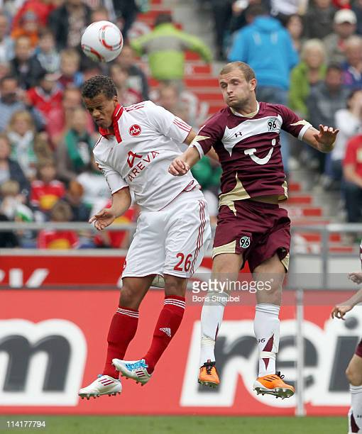 Timothy Chandler of Nuernberg and Konstantin Rausch of Hannover jump for a header during the Bundesliga match between Hannover 96 and 1 FC Nuernberg...