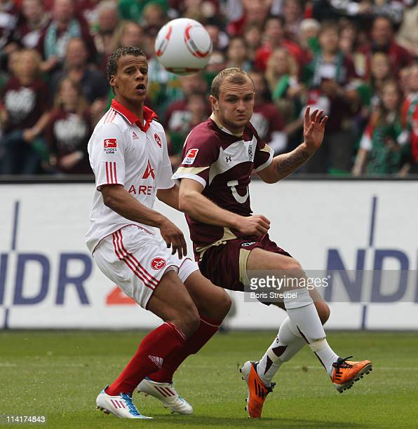 Timothy Chandler of Nuernberg battles for the ball with Konstantin Rausch of Hannover during the Bundesliga match between Hannover 96 and 1 FC...