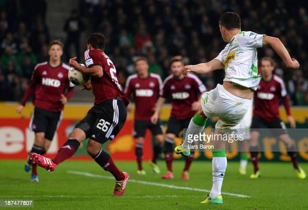 Timothy Chandler of Nuernberg blocks Granit Xhaka of Moenchngladbach during the Bundesliga match between Borussia Moenchengladbach and 1. FC...