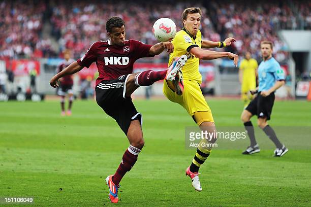 Timothy Chandler of Nuernberg is challenged by Kevin Grosskreutz of Dortmund during the Bundesliga match between 1 FC Nuernberg and Borussia Dortmund...