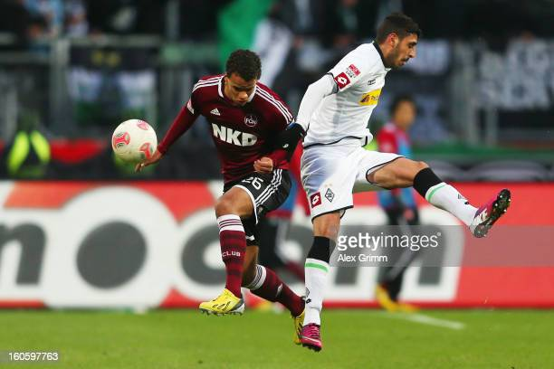 Timothy Chandler of Nuernberg is challenged by Tolga Cigerci of Moenchengladbach during the Bundesliga match between 1. FC Nuernberg and VfL Borussia...