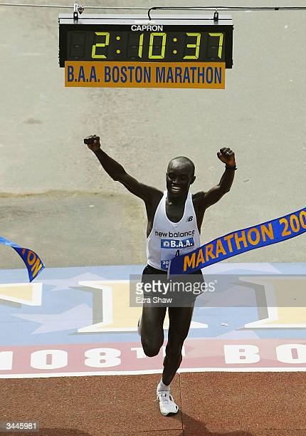 Timothy Cherigat of Kenya crosses the finish line with a time of 21037 to win the mens divison of the108th Boston Marathon on April 19 2004 n Boston...