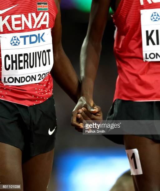 Timothy Cheruiyot and Asbel Kiprop of Kenya hold hands after the Men's 1500 metres final during day ten of the 16th IAAF World Athletics...