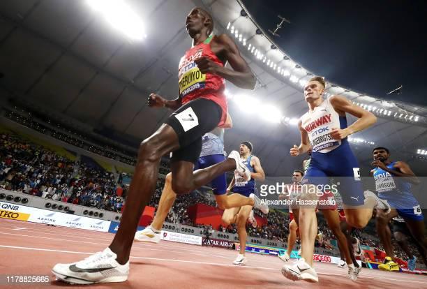 Timothy Cheruiyot of Kenya and Filip Ingebrigtsen of Norway compete in the Men's 1500 Metres heats during day seven of 17th IAAF World Athletics...